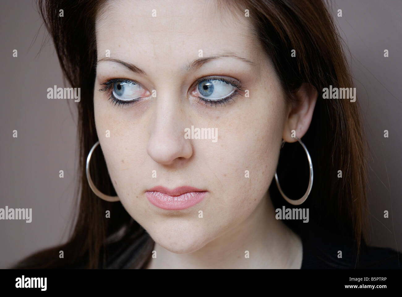 A young woman with an anxious expression - Stock Image