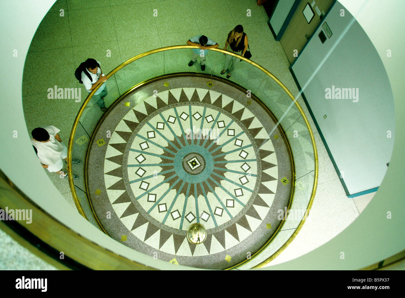 Foucault pendulum, students & visitors. - Stock Image