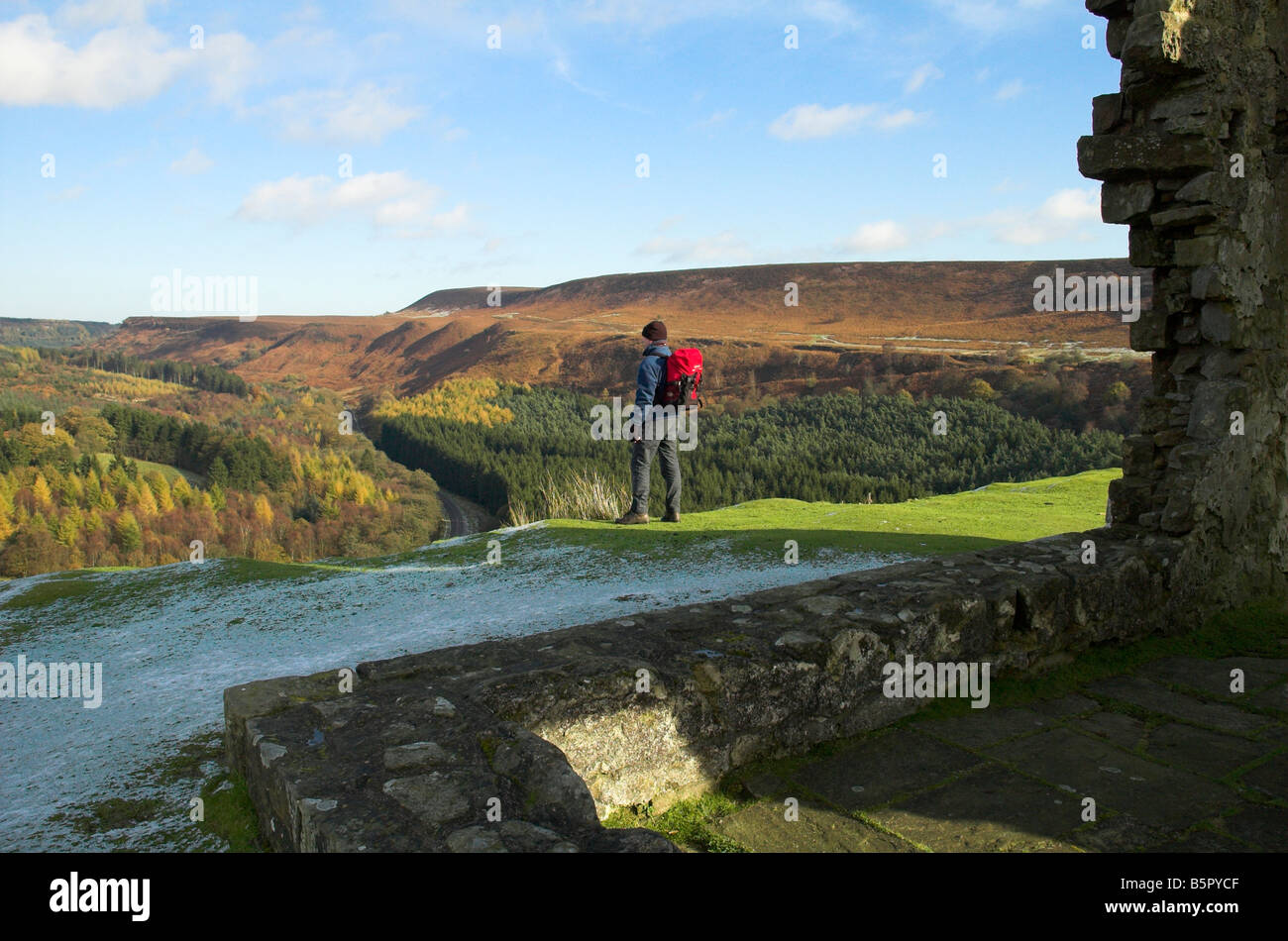 A walker at Skelton Tower overlooking Newton Dale in the North York Moors. - Stock Image