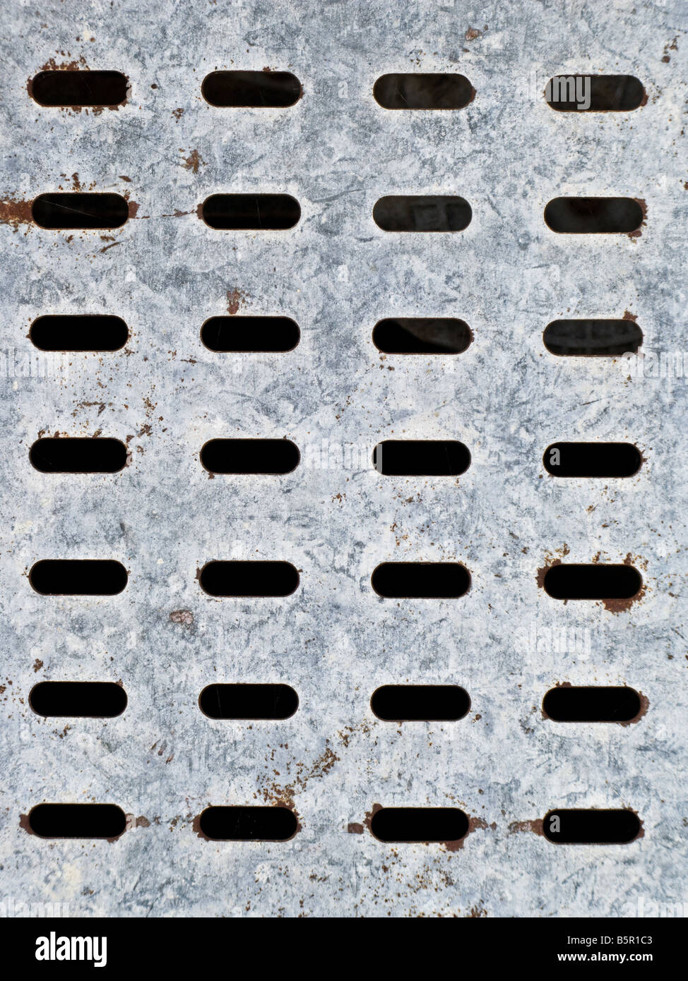 Perforated galvanized plated metal surface. Abstract background texture. - Stock Image