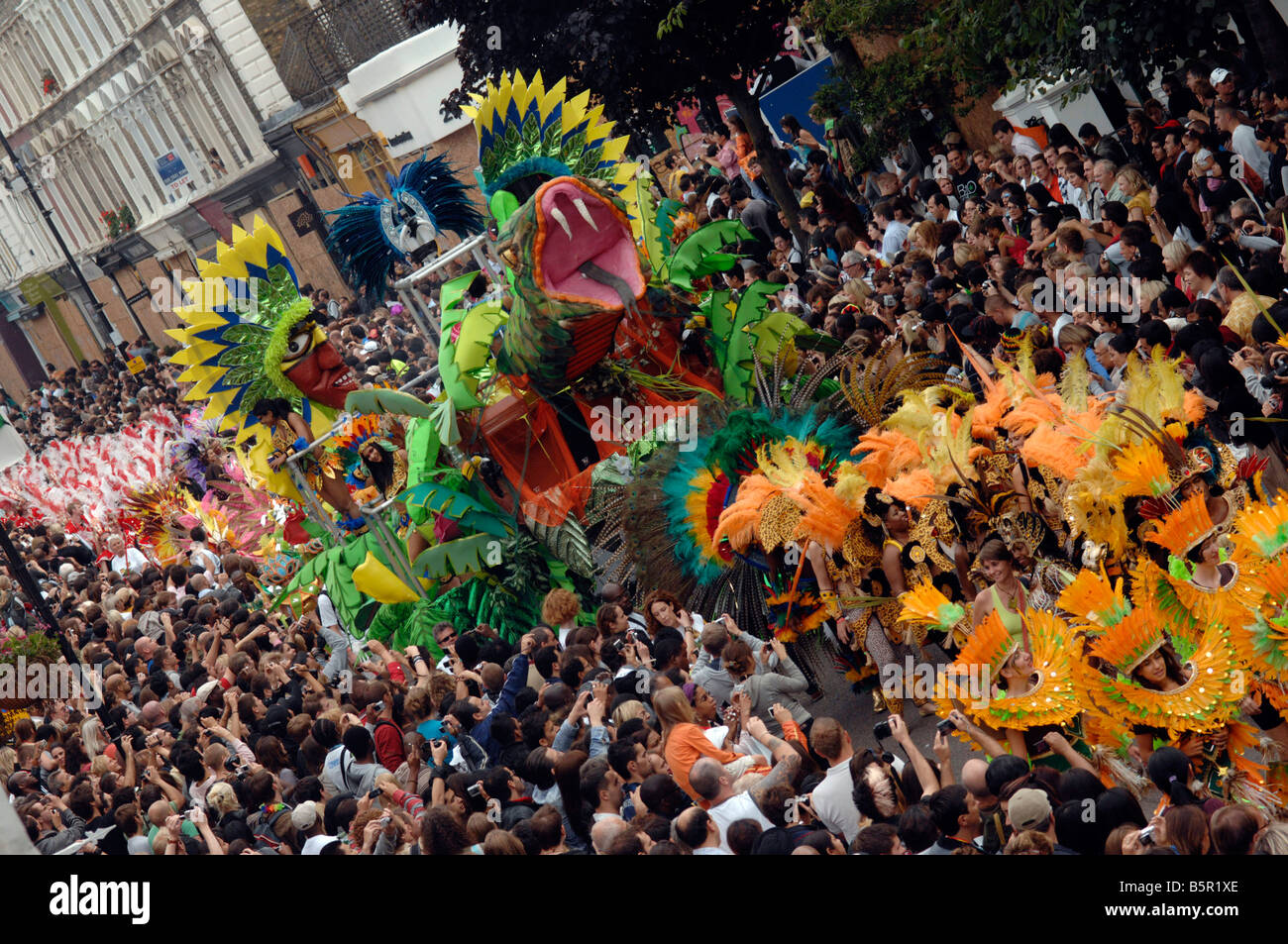 An elaborate float and procession makes its way through the crowds of revellers at 2008's Notting Hill Carnival - Stock Image