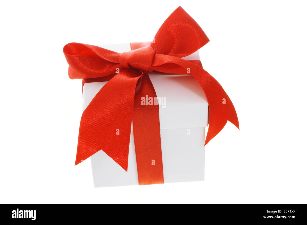 Gift box with red bow ribbon on white background Stock Photo