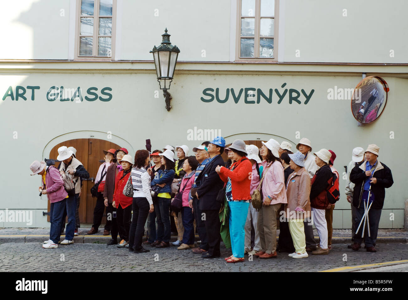 Organized group of tourists on a guided tour in Prague - Stock Image