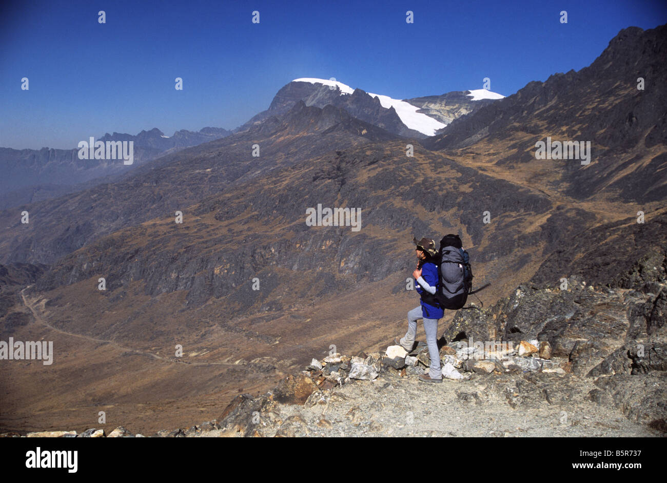 Trekker looking at view on the Takesi Inca Trail from Abra Takesi, Mount Mururata in background, Cordillera Real, - Stock Image