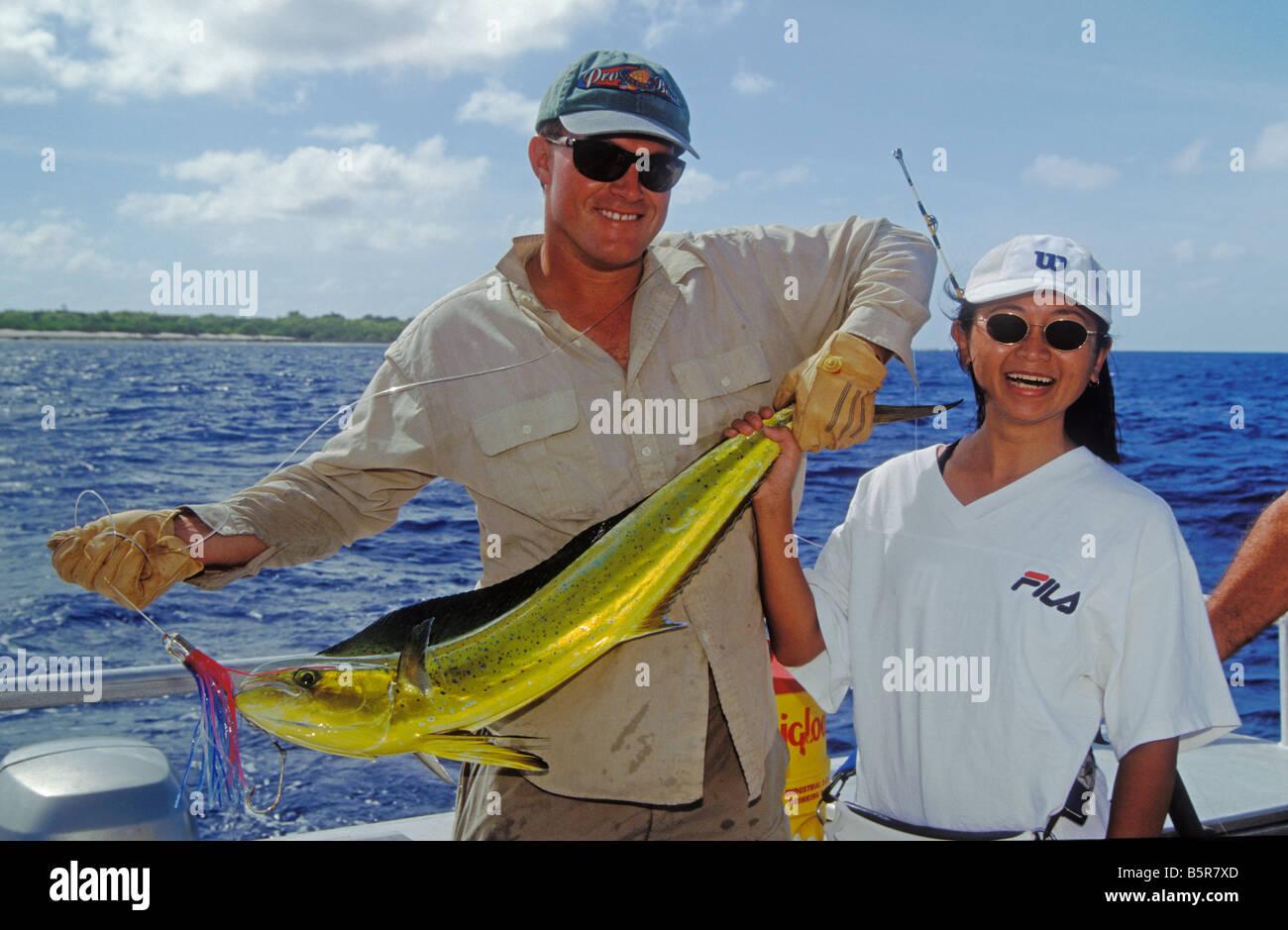 Marshall Islands Micronesia Fishing Guide Rod Bourke and Japanese visitor Yuki Nakako with Mahimahi caught at Bikini - Stock Image
