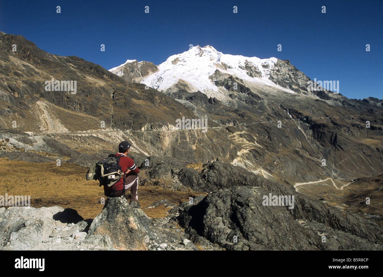 Male trekker looking at view near Mt Huayna Potosi, Cordillera Real, Bolivia - Stock Image