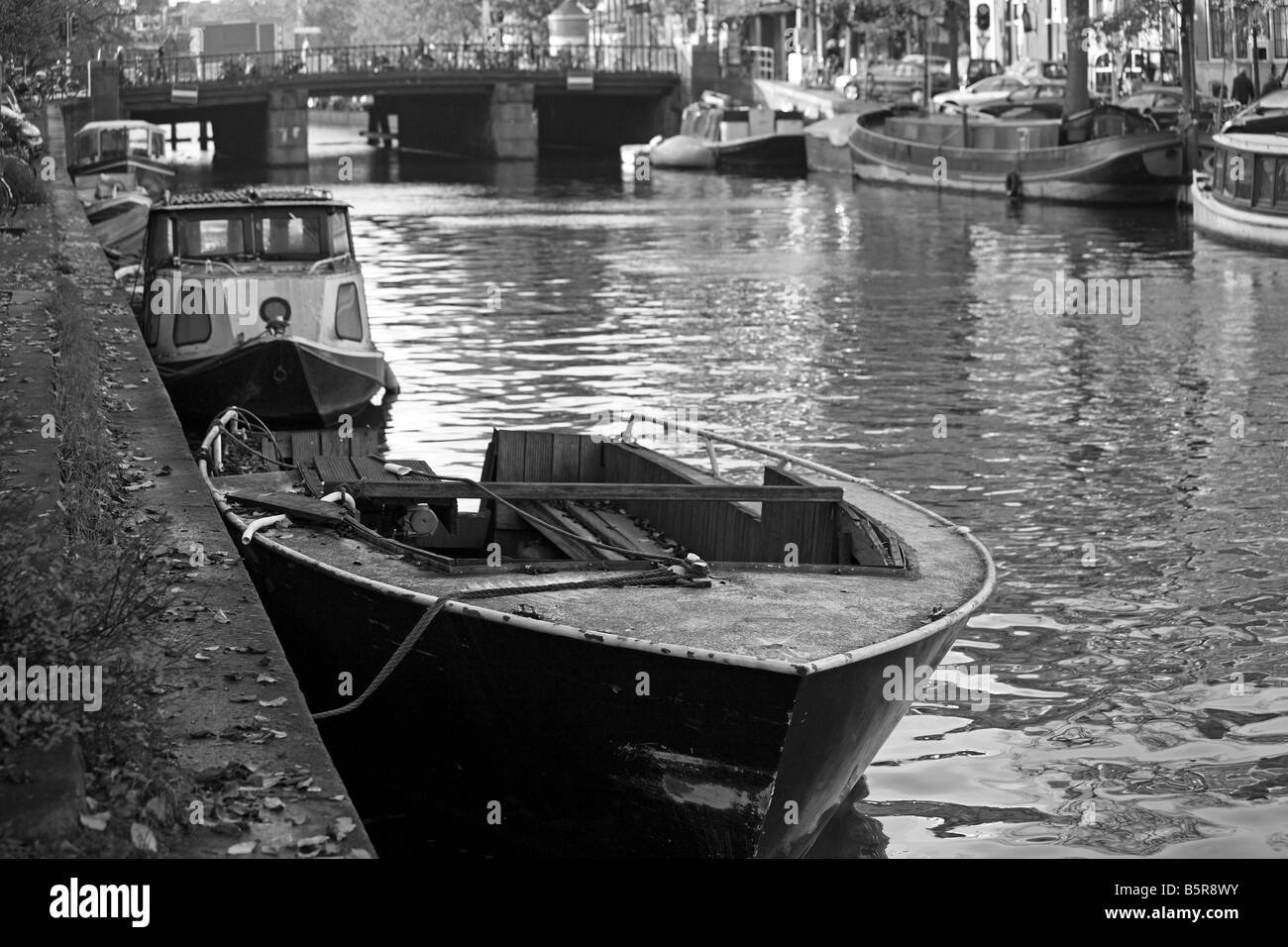Boats and barges lined up on the canal on Prinsengracht,Amsterdam - Stock Image