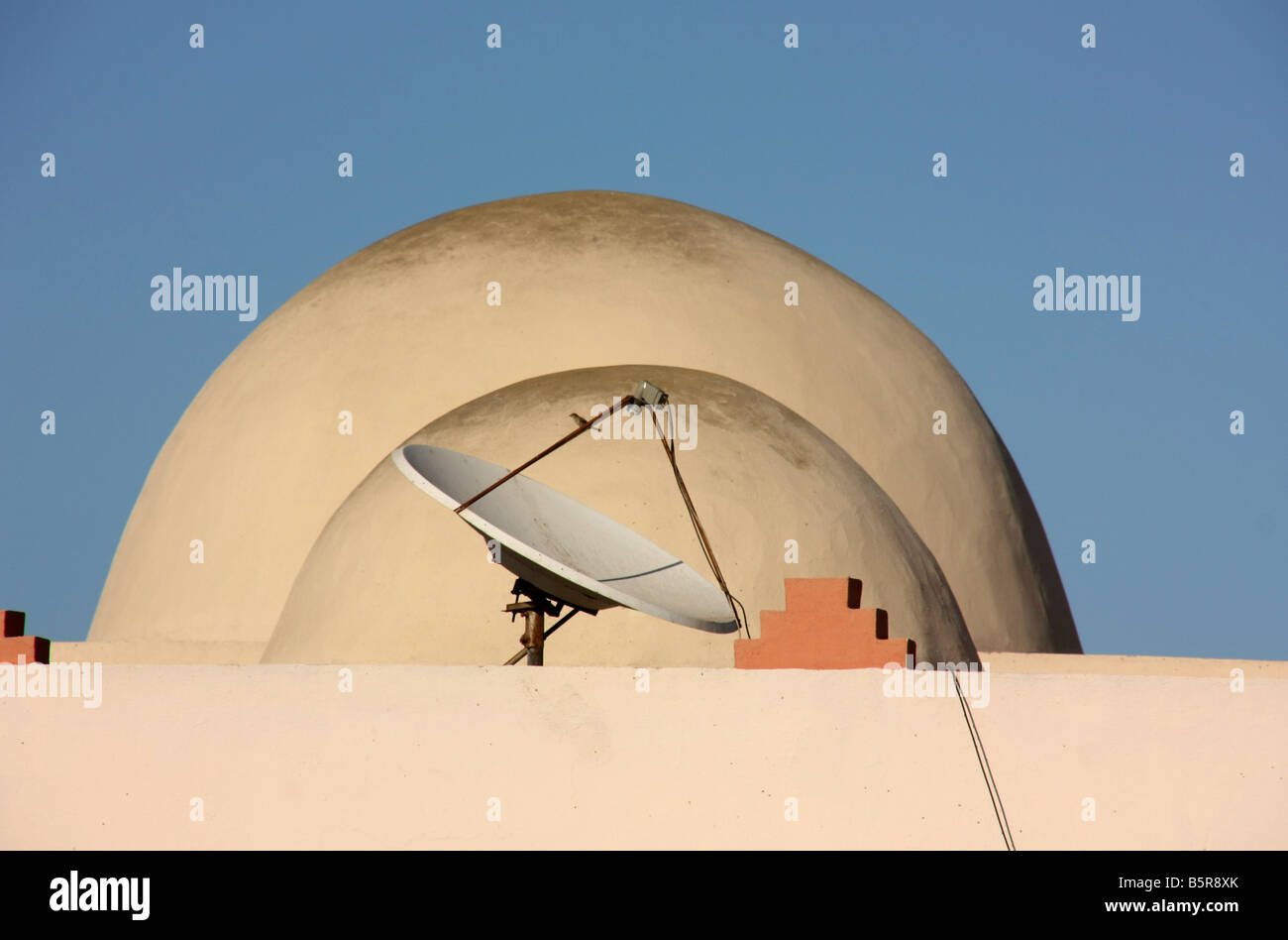 Traditional domed roofs and satellite dish Dakhla Western Sahara - Stock Image
