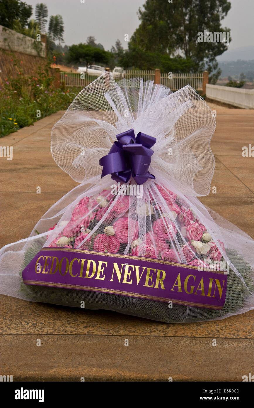 A bouquet of flowers is placed on a mass grave at the Rwanda Genocide Museum in Kigali with the saying, 'We - Stock Image