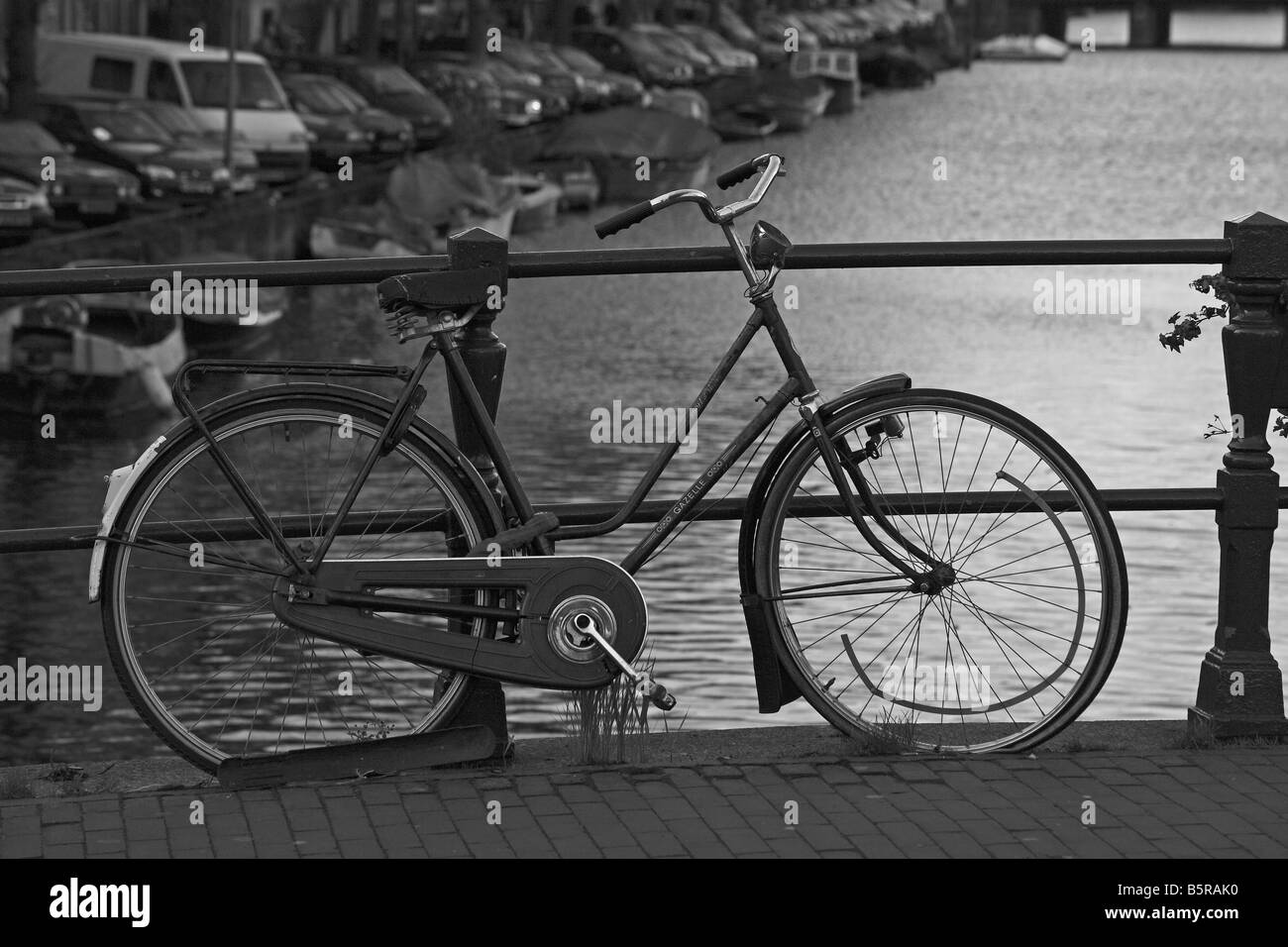 A dutch bicycle on the bridge at the Prinsengracht in Amsterdam - Stock Image