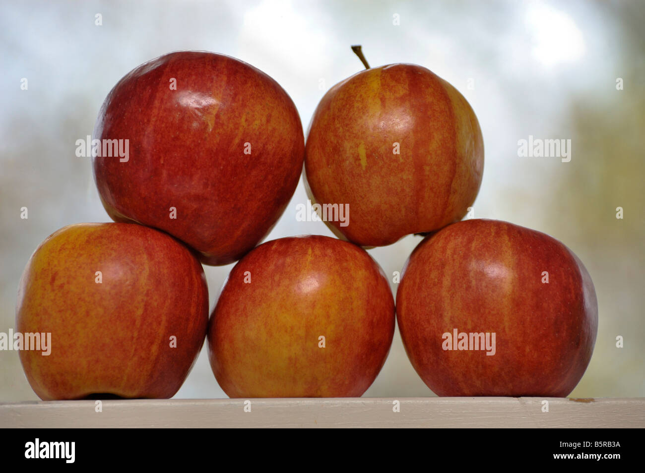 Apples stacked on a window sill Stock Photo