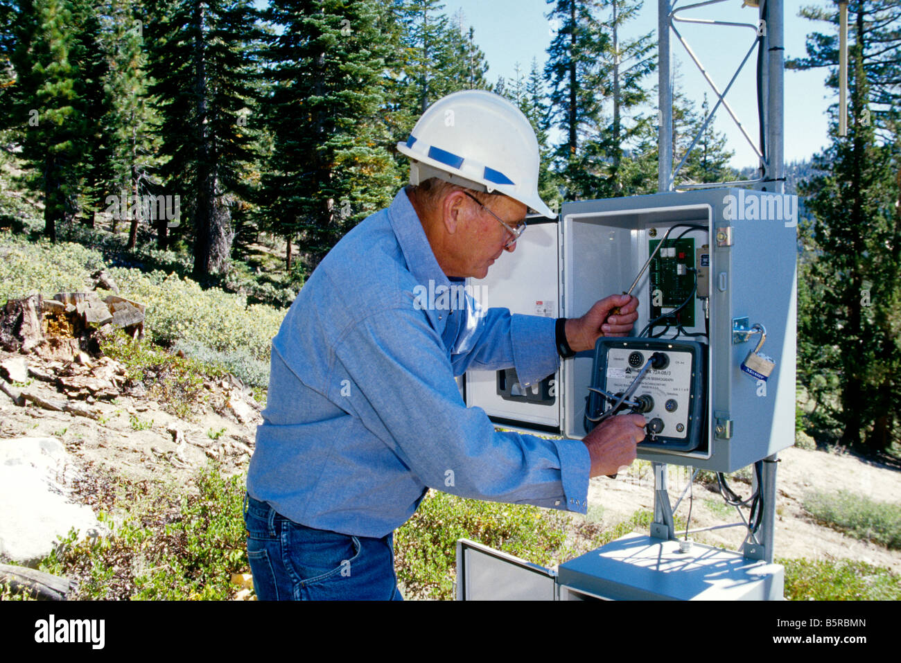 Seismological Station, technician checking. - Stock Image