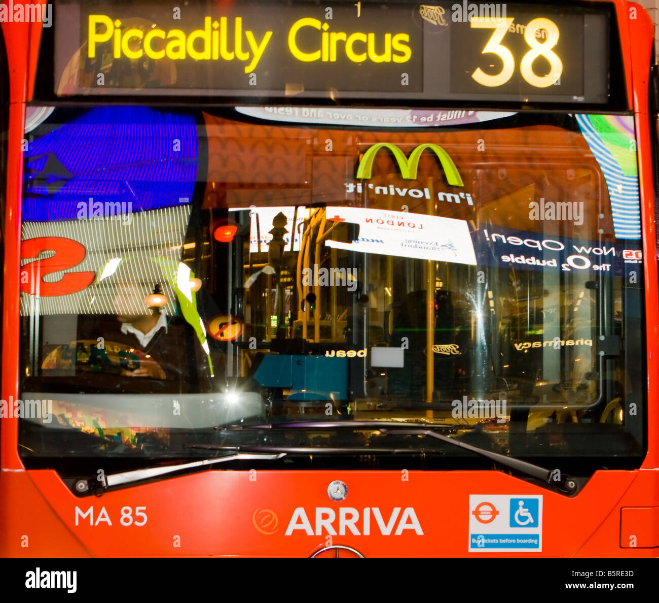 Reflections in Bus Window in Piccadilly Circus - Stock Image