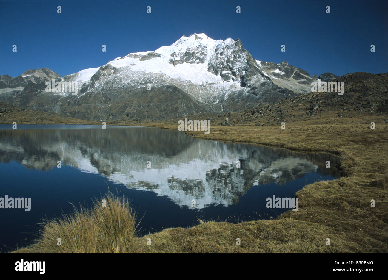 Mt Huayna Potosi reflected in lake, Cordillera Real, Bolivia Stock Photo