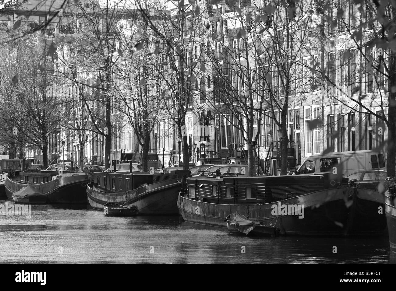 Boats and barges lined up along the Prinsengracht, Amsterdam, Netherlands - Stock Image