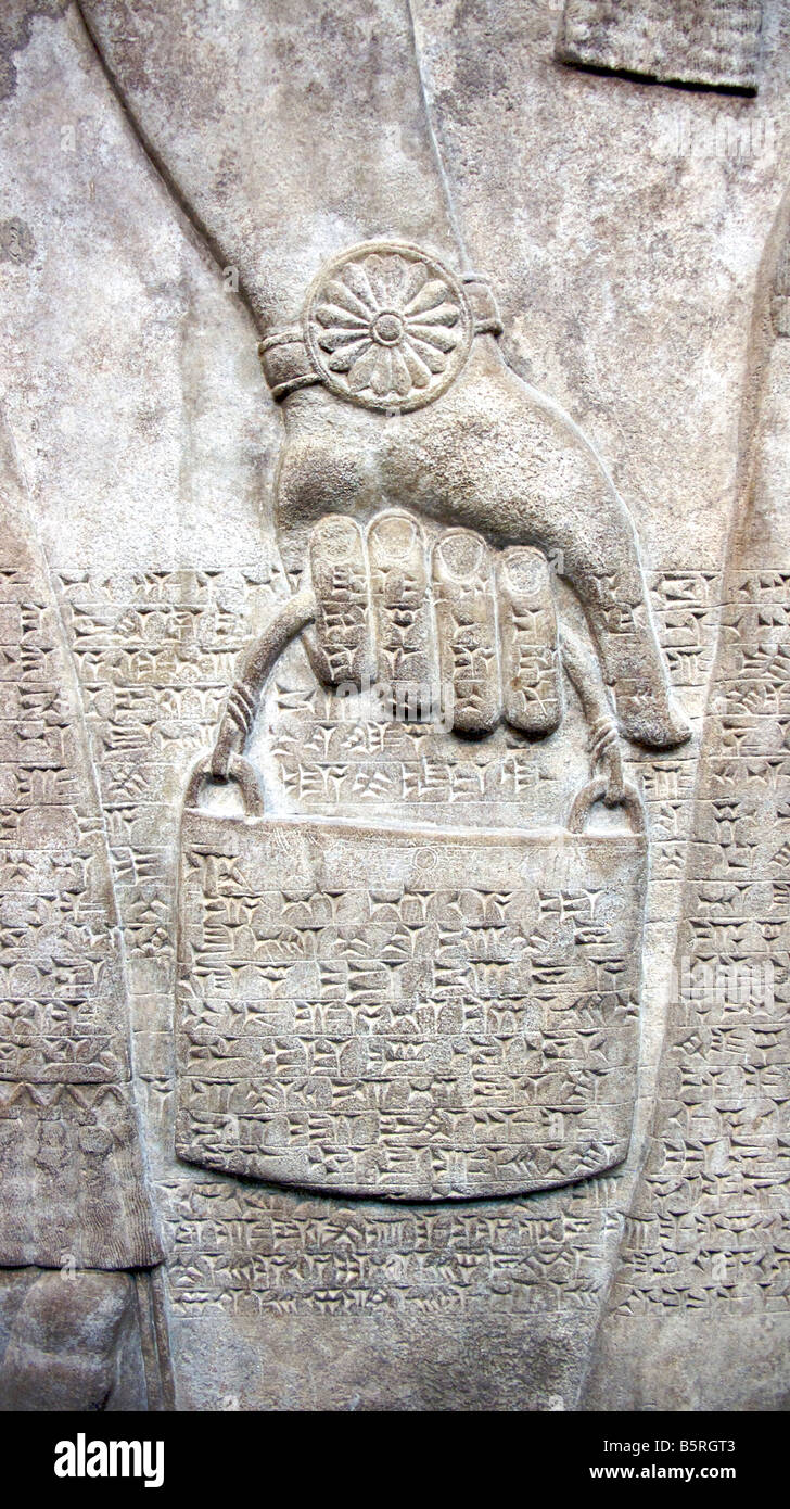 Ancient Assyrian carving of a bag - Stock Image