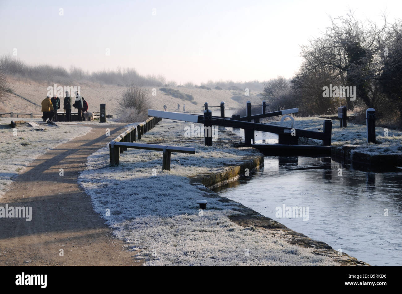 crowd of friends on the canal towpath on a cold frosty morning Chesterfield Derbyshire - Stock Image