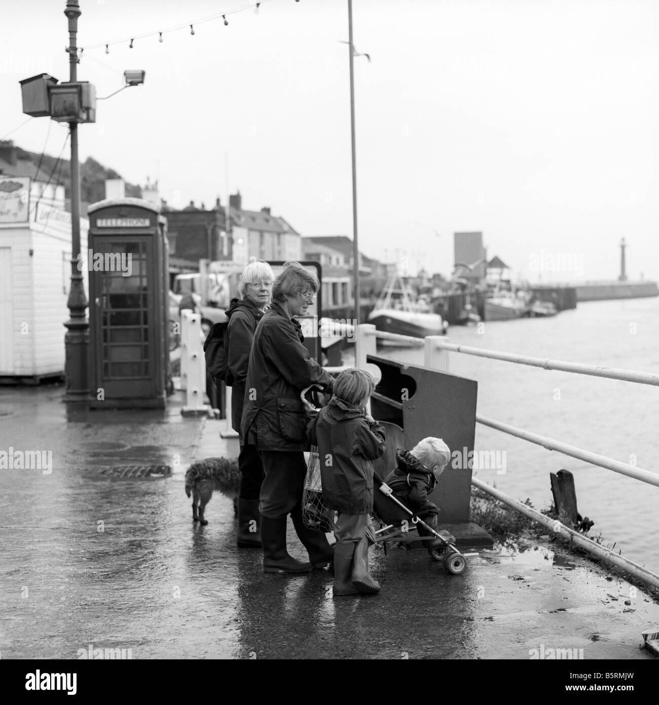 UK England Yorkshire Whitby quayside K6 phone boxes black and white - Stock Image