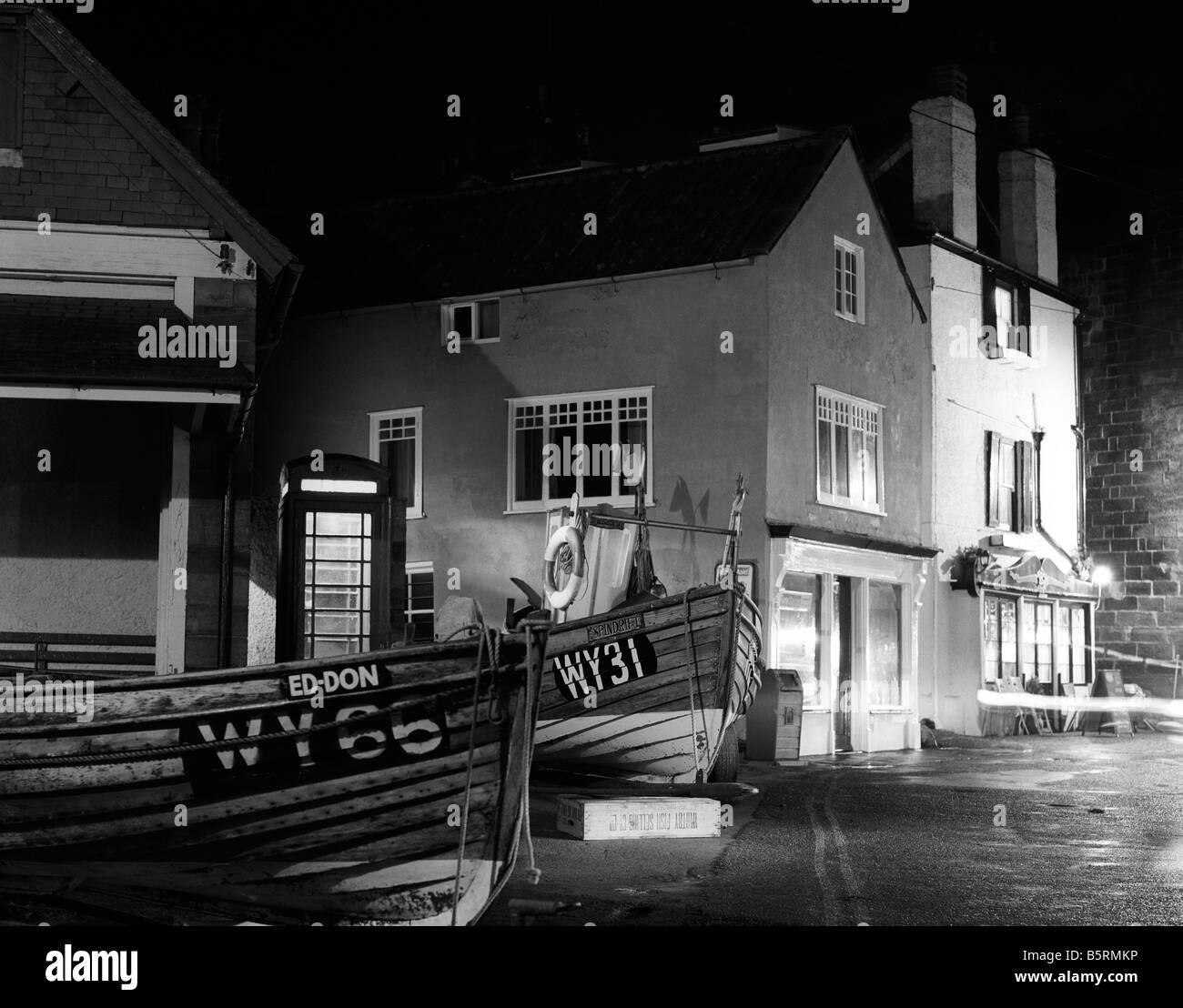 UK England Yorkshire Robin Hoods Bay evening harbourside K6 phone box black and white - Stock Image