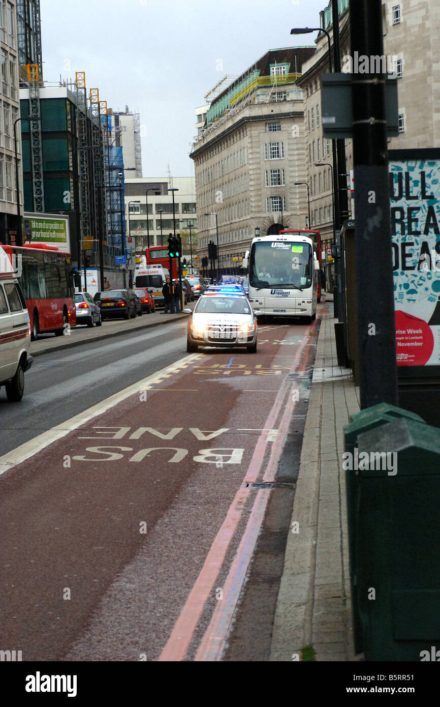 Police car speeding in a bus lane in London during an emergency Stock Photo