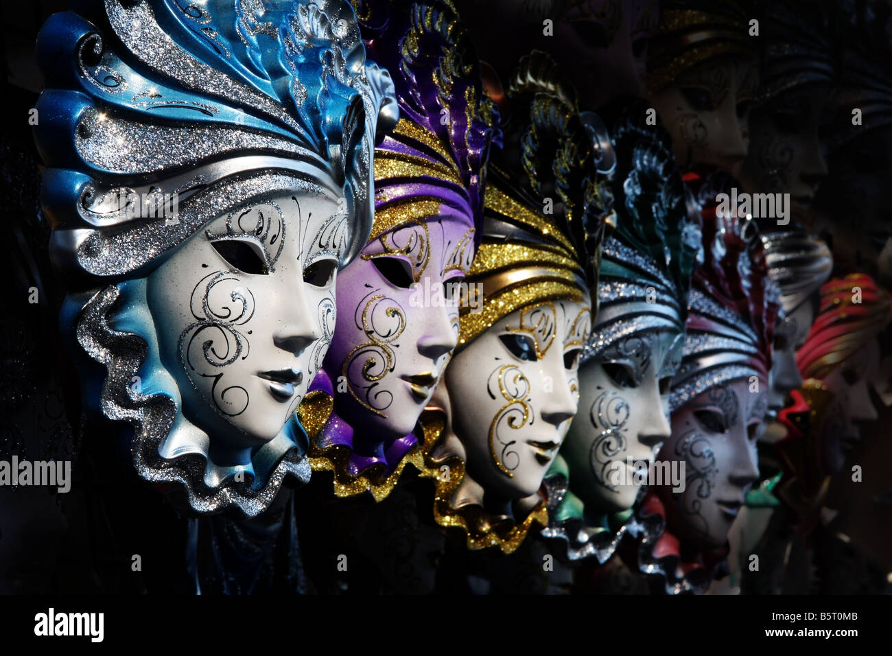 Row of venetian masks in gold and blue - Stock Image