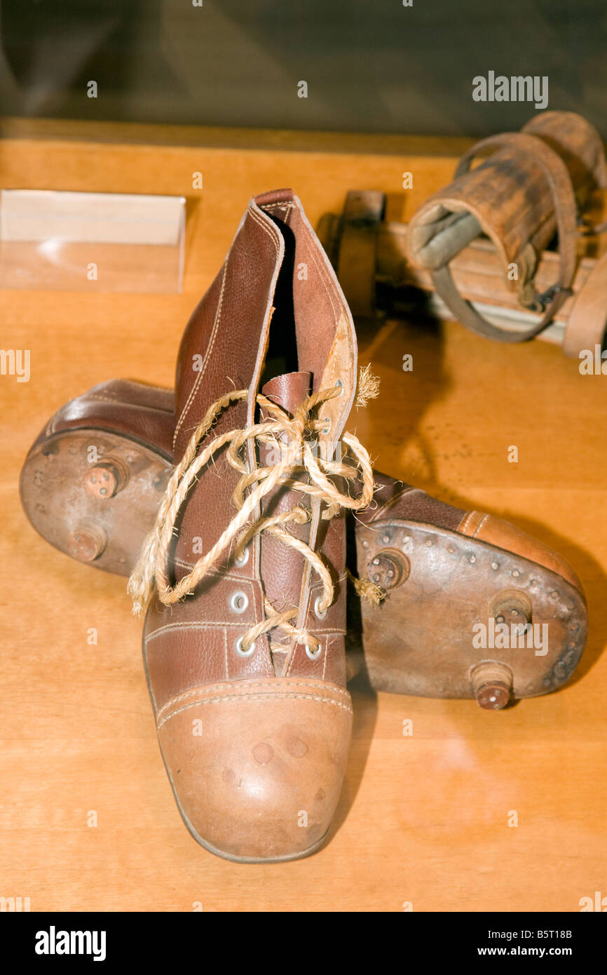 An old pair of football boots antique leather soles and studs l at Nou Camp, Barcelona Catalonia Spain - Stock Image