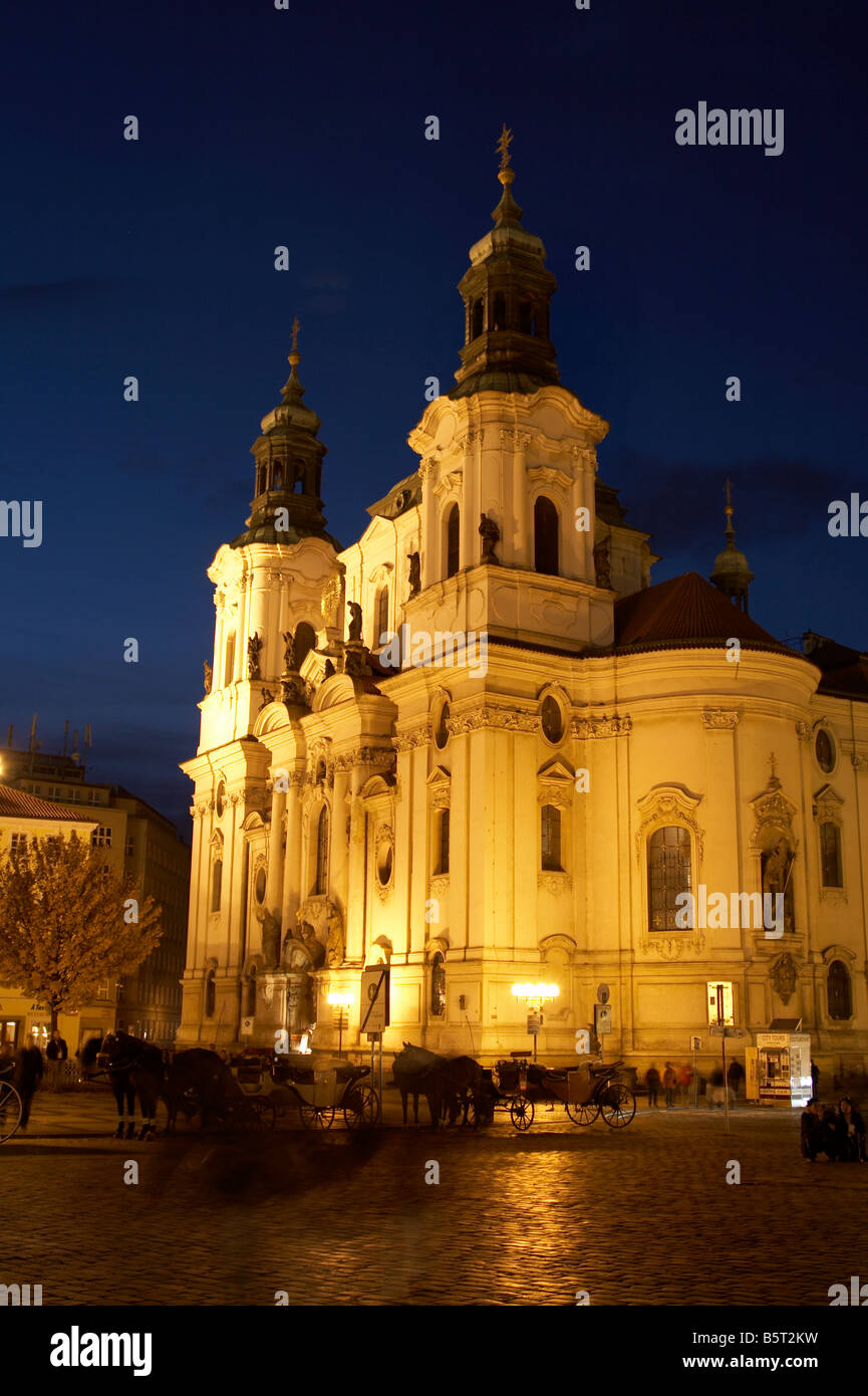 St Nicholas Church at the the Old Town Square (Staroměstské náměstí) at night, Prague - Stock Image
