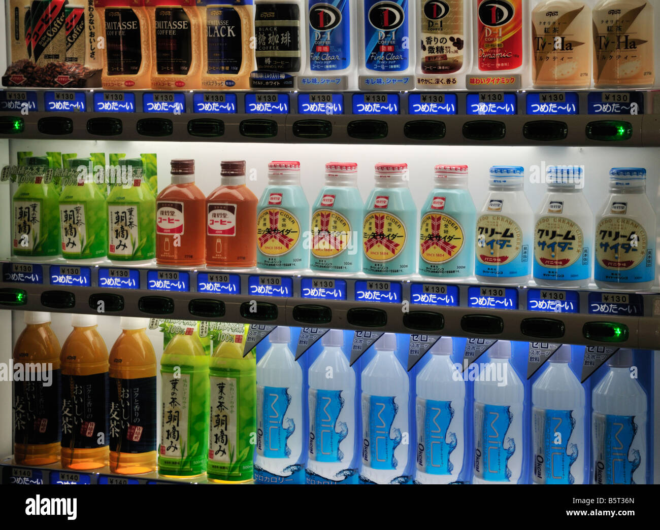 Japanese drinks vending machine showing green tea, coffee and alcoholic drinks Stock Photo