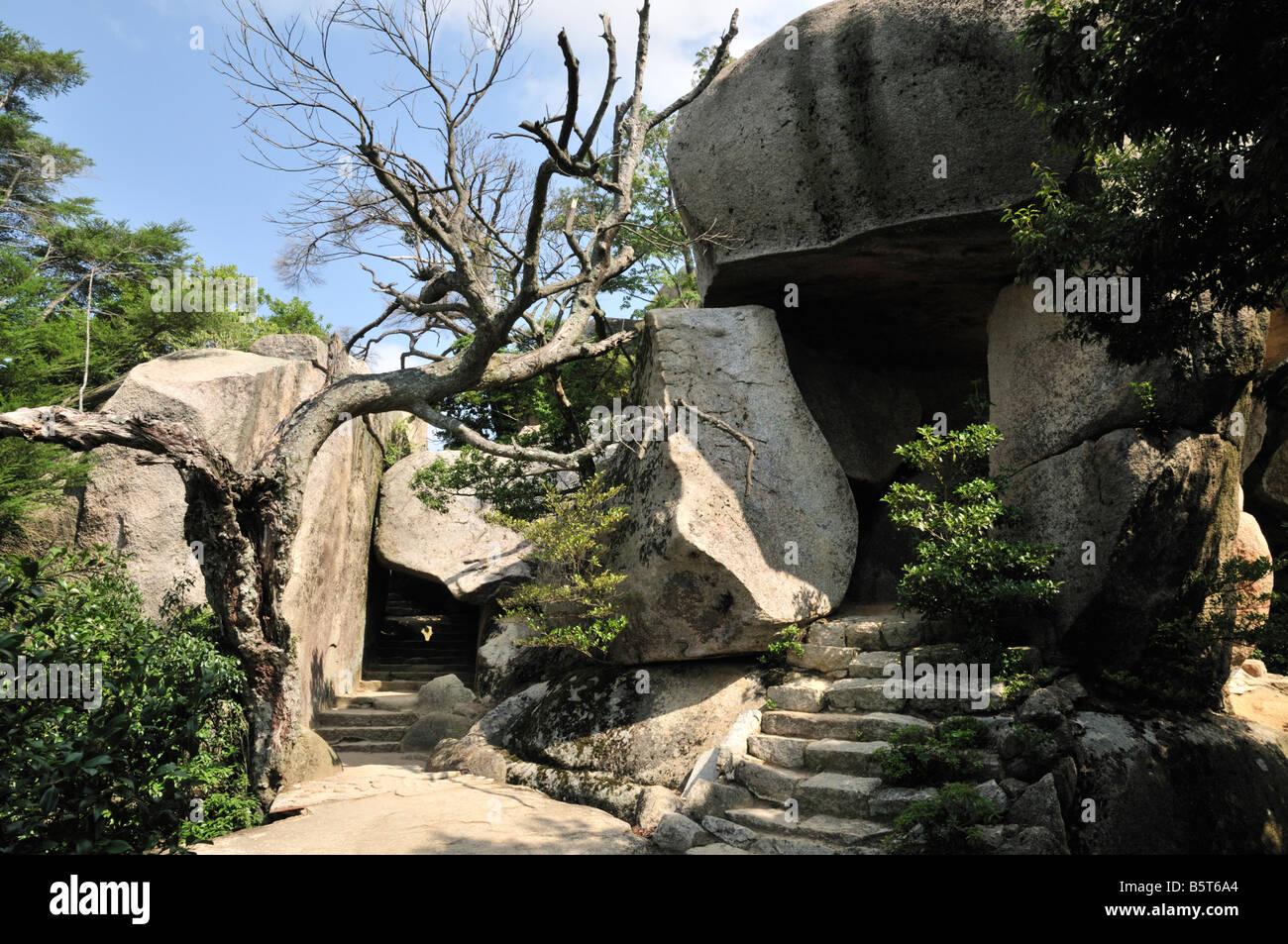 Kuguri-iwa (Duck-under Rock) and Fudo-iwa (Acala Rock) on the Mount Misen walk, Miyajima Island, Japan - Stock Image