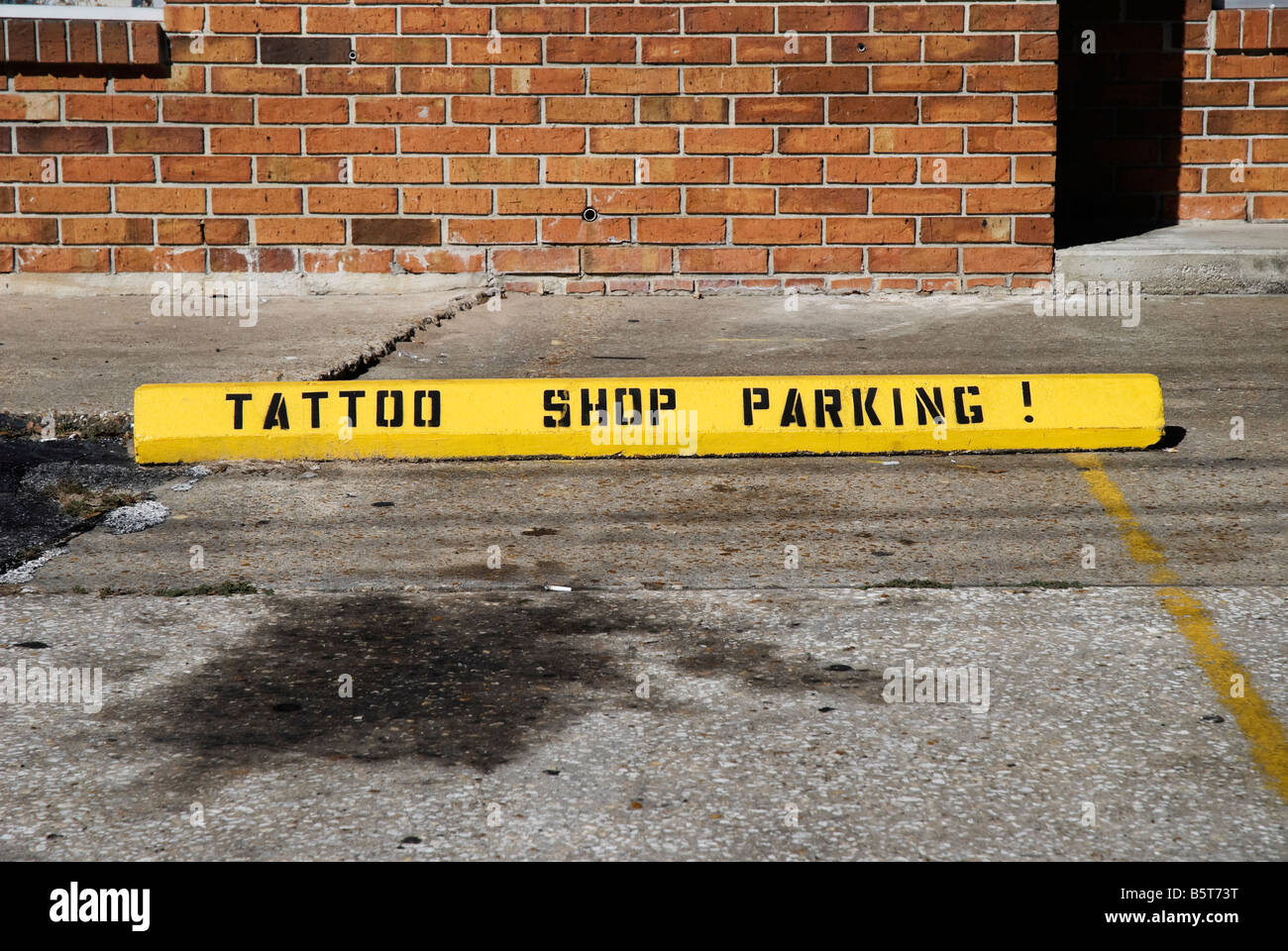 parking designation for tattoo shop - Stock Image