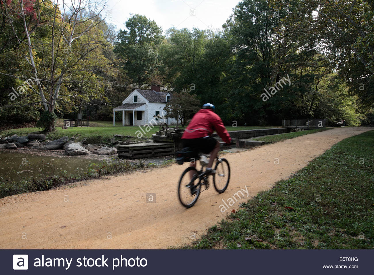 Cyclists ride the C&O Canal towpath near Lock 7 in Maryland. - Stock Image