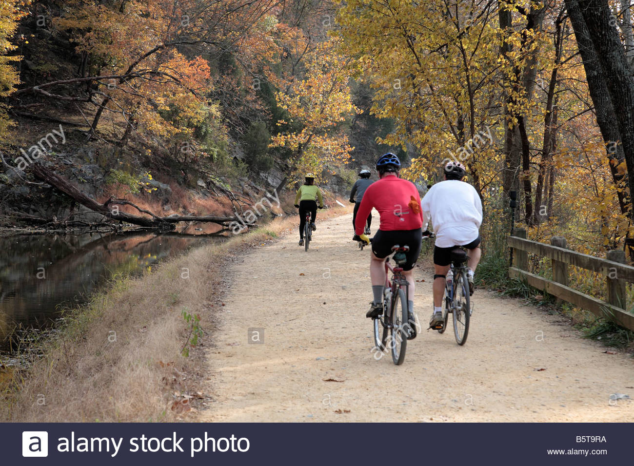 Cyclists on the C&O Canal towpath near Great Falls in Maryland. - Stock Image