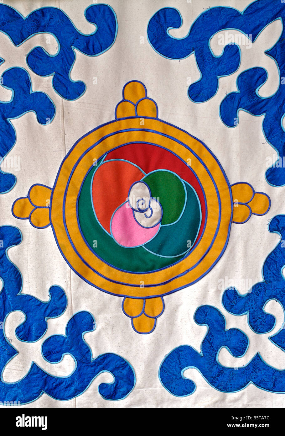 Detail of an applique decorated hanging at the Jokhang monastery. Lhasa, Tibet - Stock Image