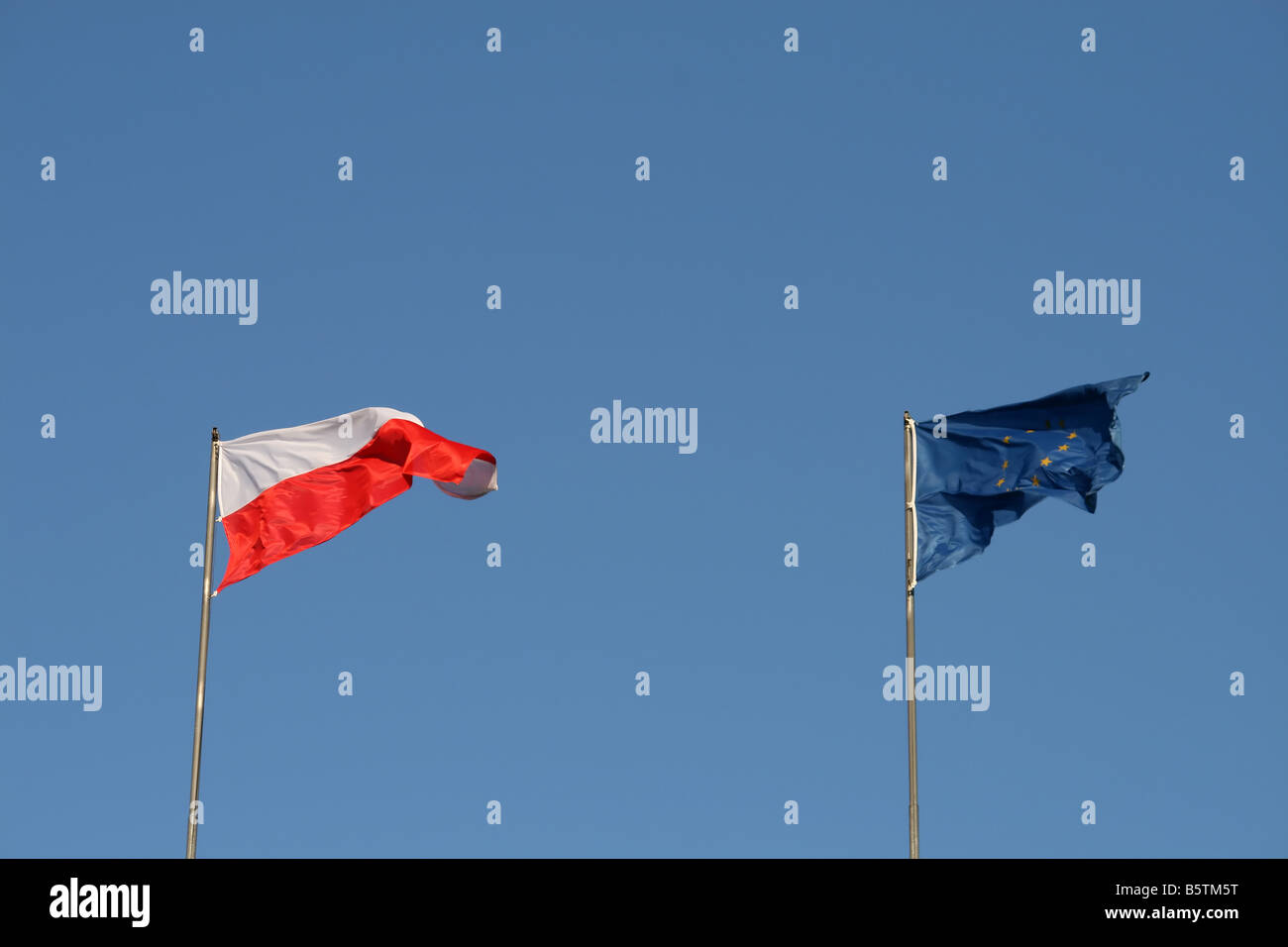polish and european union flags on the wind - Stock Image