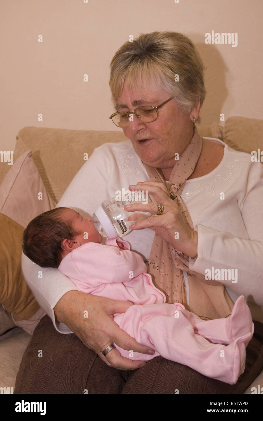 grandmother person woman bottle feeding new born 1 week old baby