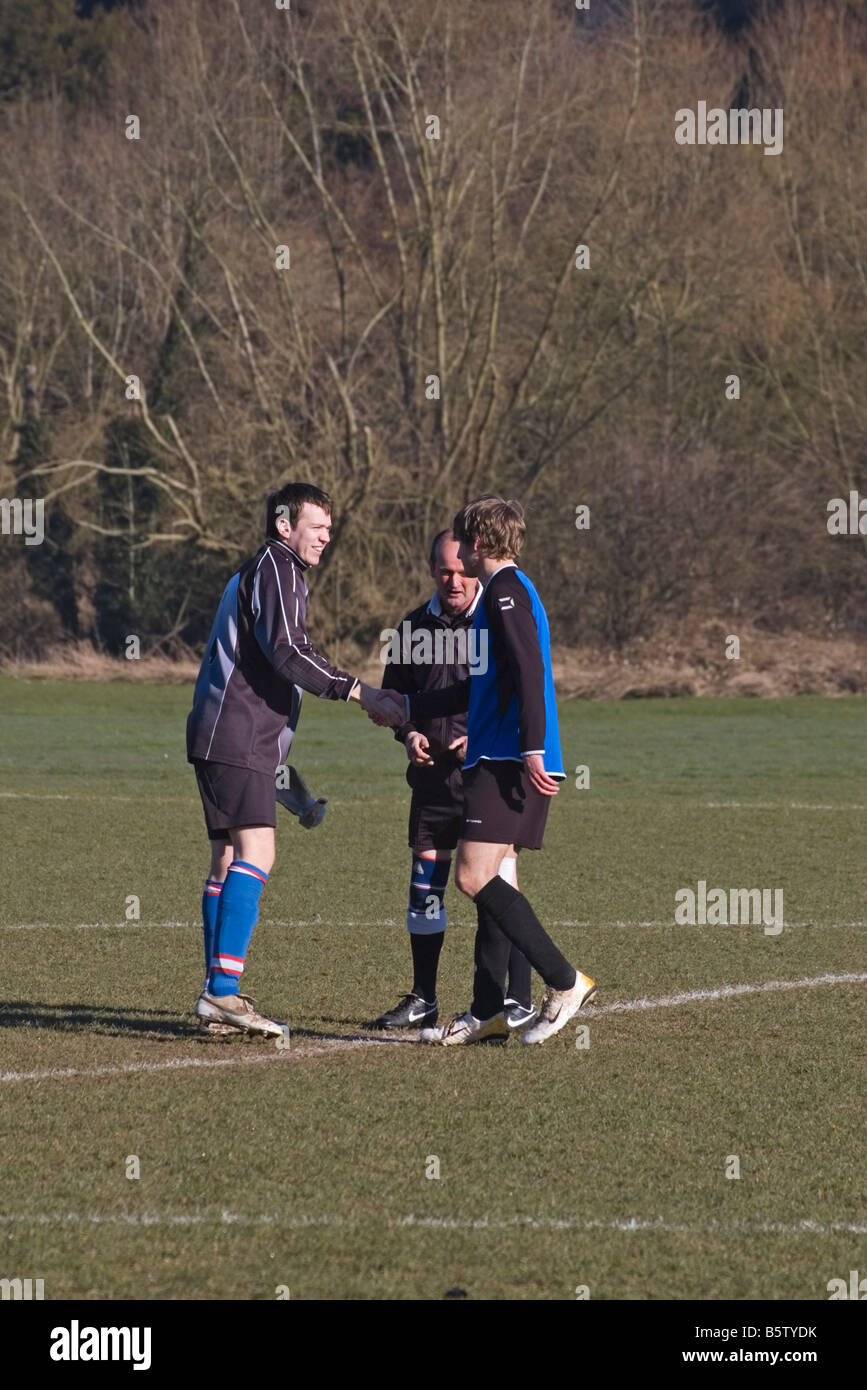 Amateur Football Match official Referee and 2 Captains - Stock Image