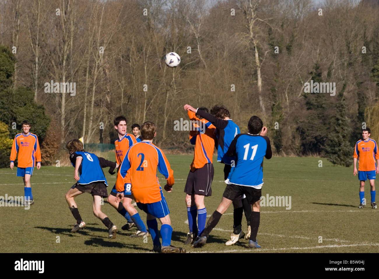 Amateur 'sunday league' Football Match Players Challenging For The Ball - Stock Image