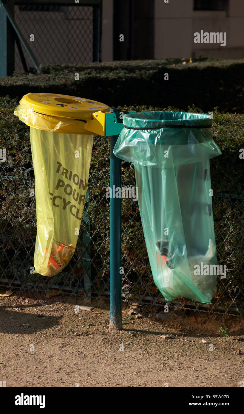 Litter bins in Paris France with yellow bin for recycling Stock Photo