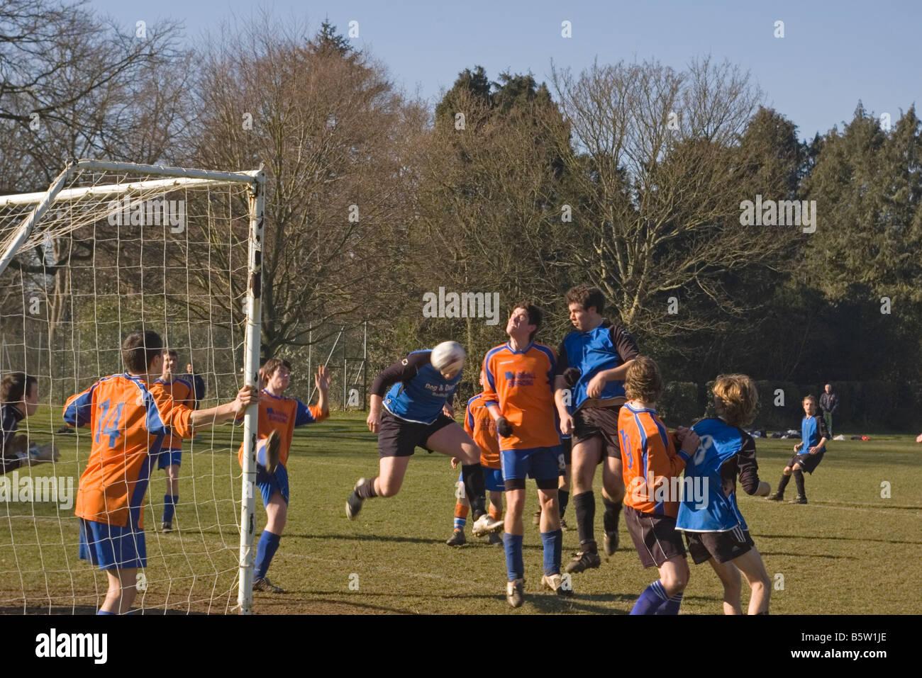 Amateur 'sunday league' Football Match Striker Heads A Goal - Stock Image