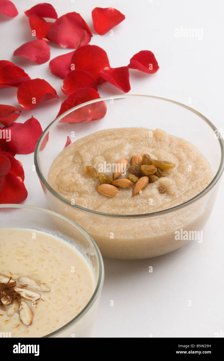 Close-up of rice pudding and halva in bowls - Stock Image