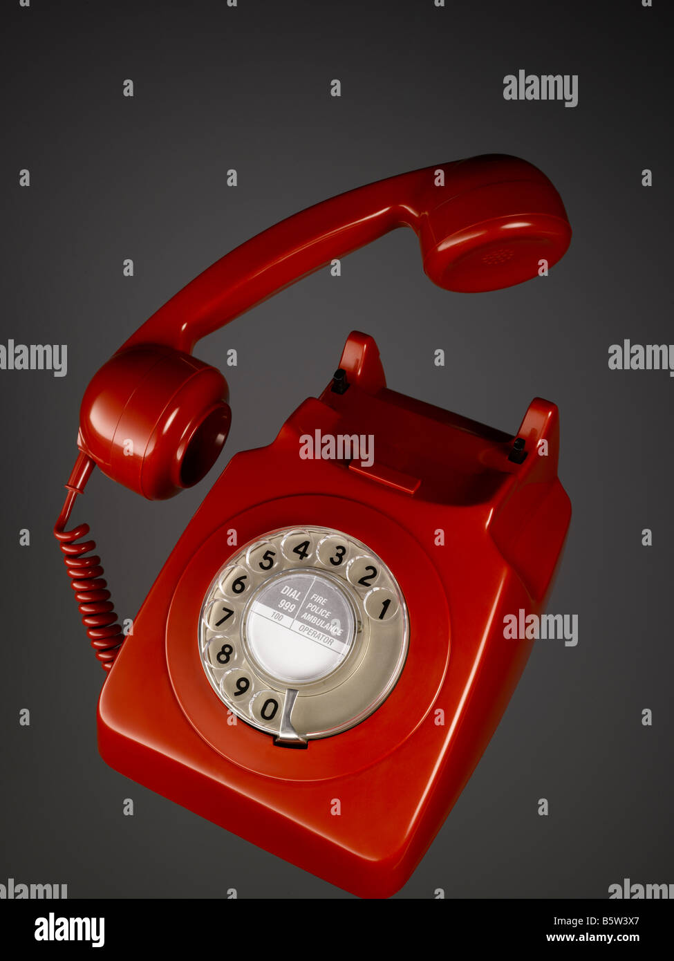 A classic red bakelite telephone - Stock Image