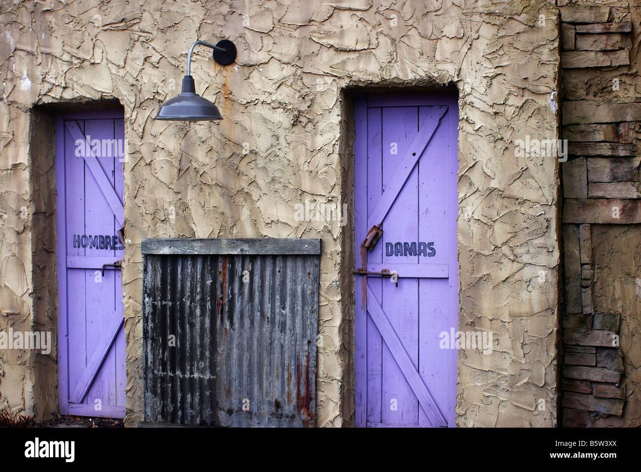 Purple doors to a restaurant s restrooms Stock Photo