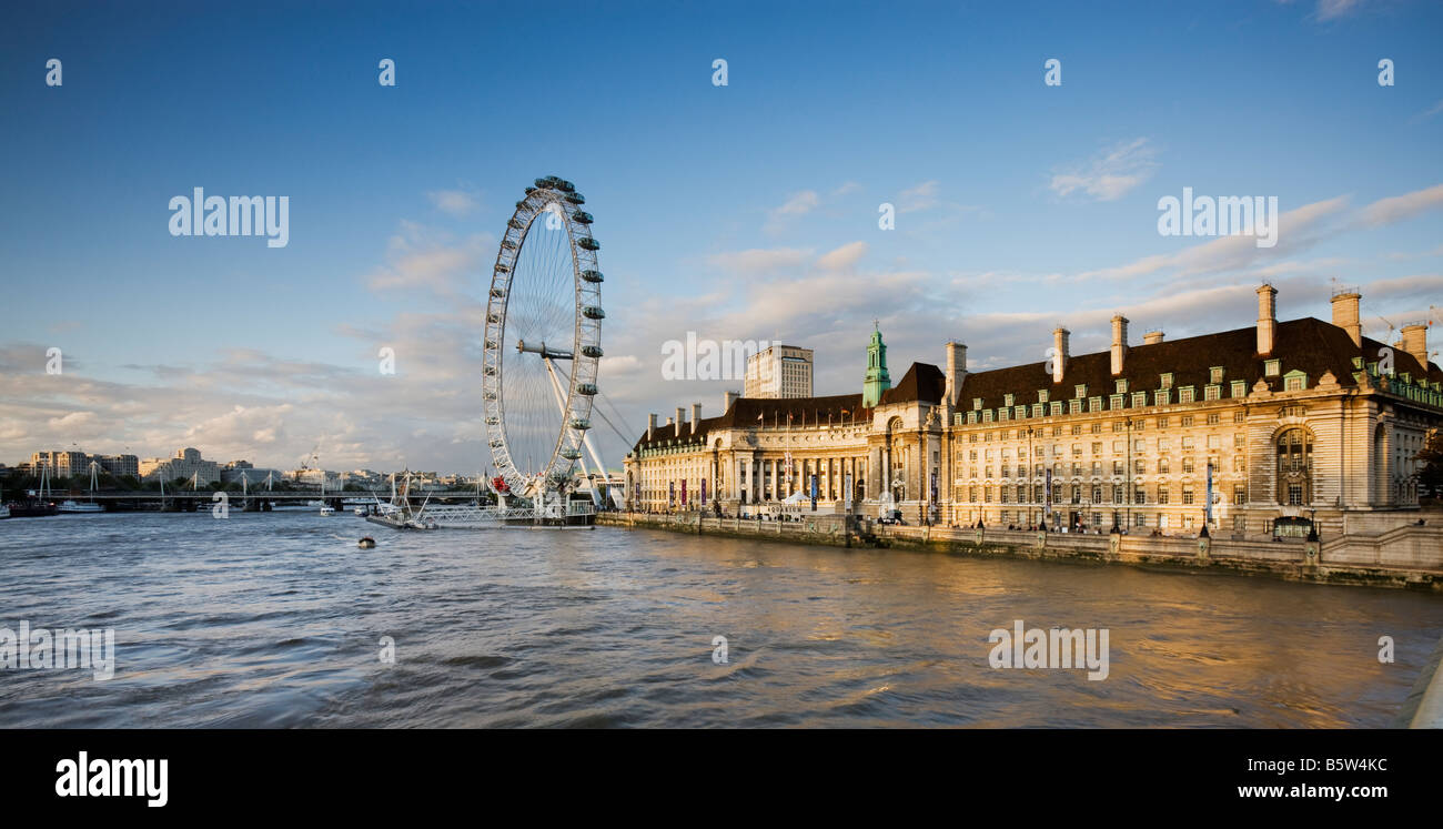 UK London Eye and the London County Hall viewed over the River Thames - Stock Image
