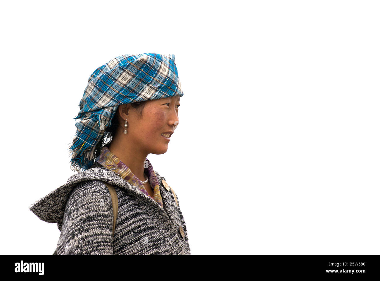 Tibetan woman against white sky - Stock Image