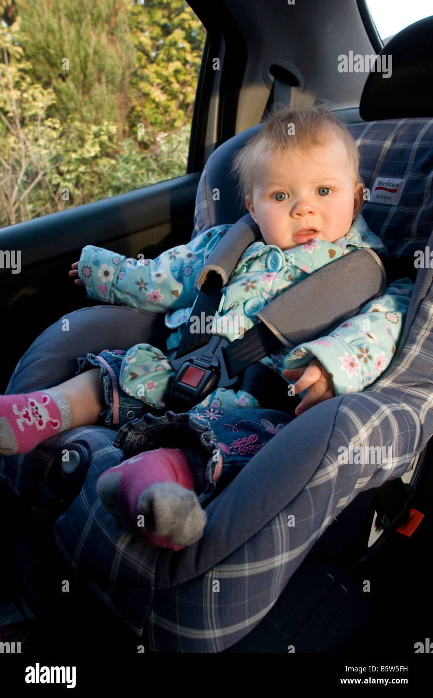 child seat kid baby car in safety safe strapped in strap seat belt ...