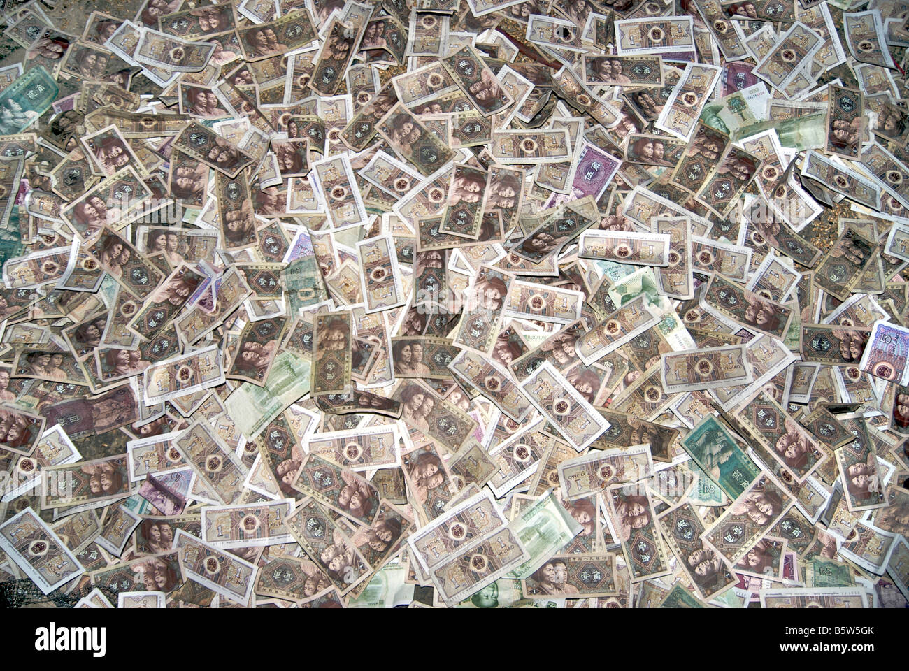 Chinese banknotes donated to the monastery. Drepung, Lhasa, Tibet - Stock Image
