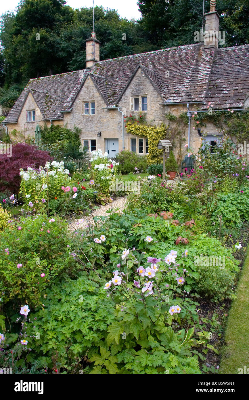 Cotswold stone cottage and garden in Bibury Gloucestershire England - Stock Image