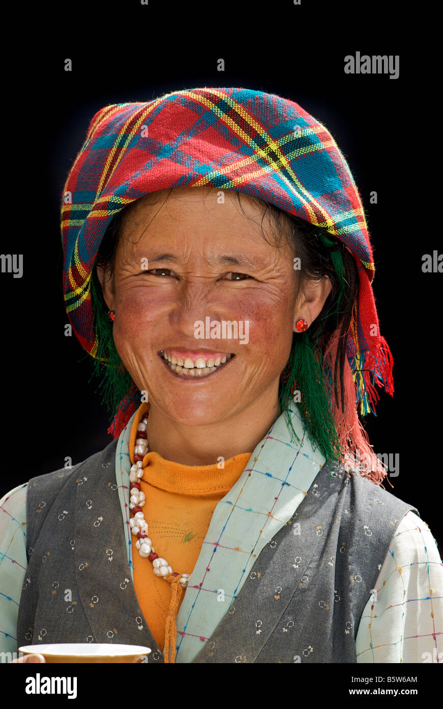 Friendly Tibetan woman. Smiling. Tibet - Stock Image