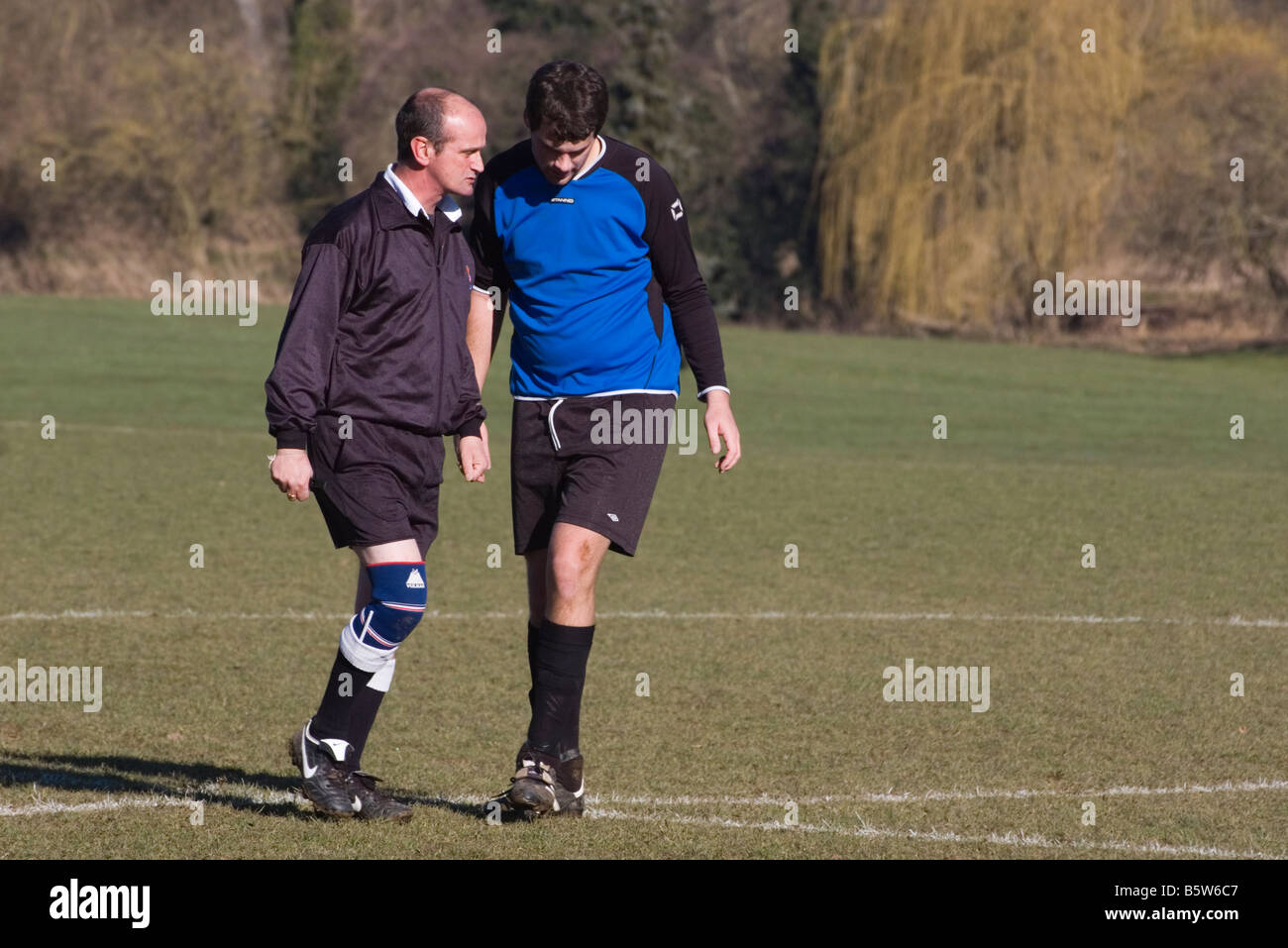 Amateur Football Match official Referee Warning a Player - Stock Image