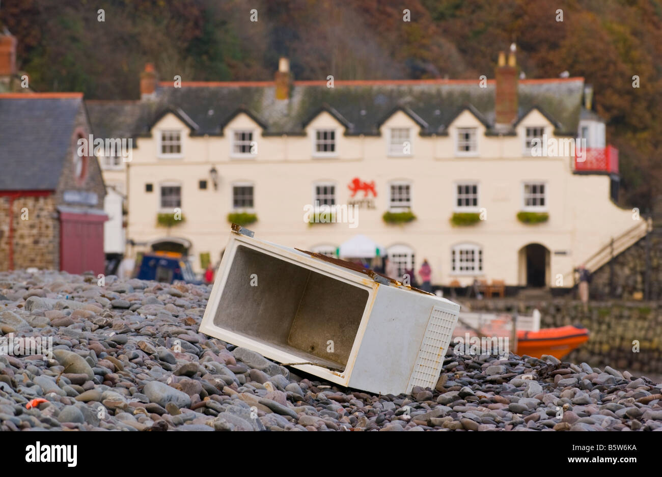 Freezer washed up on pebble beach in the coastal village of Clovelly North Devon England UK - Stock Image